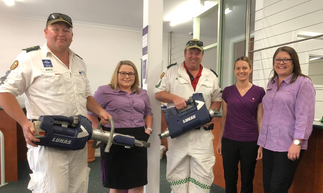 HELP OUT: Leeton VRA's Paul Smith (left) and Glen Newman with Beyond Bank's Eliza Smith, Ash Melzer and Amber McKenzie. Photo: Talia Pattison