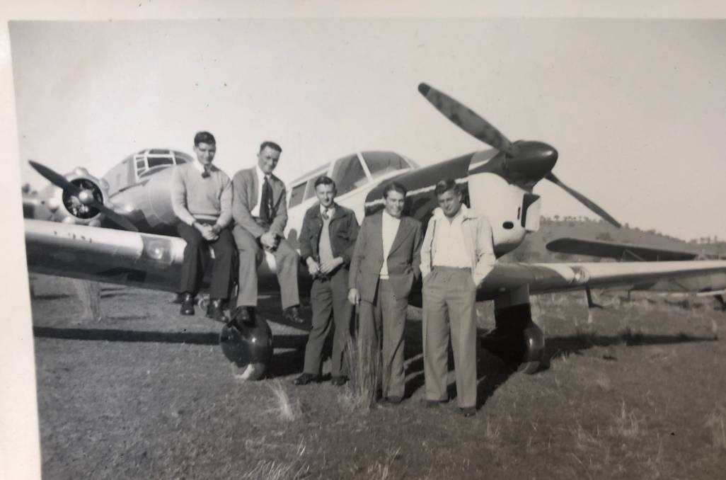 HISTORY: One of the images found featured Leeton residents, including Jim Tiffen Senior, with a special Tiger Moth plane. Photo: Contributed
